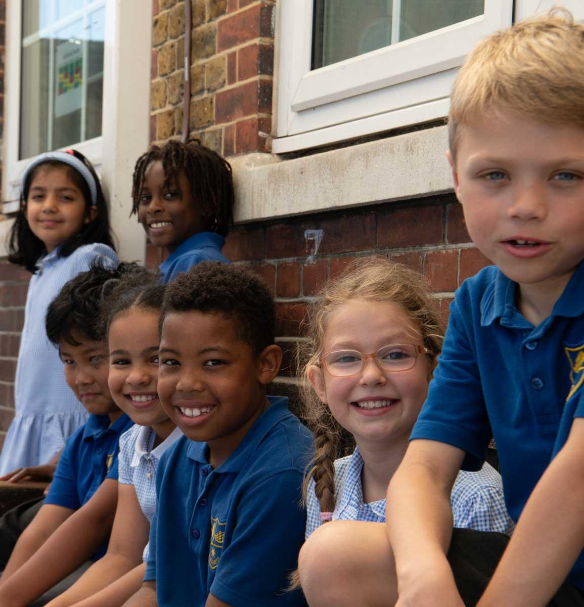 Children sitting on a bench